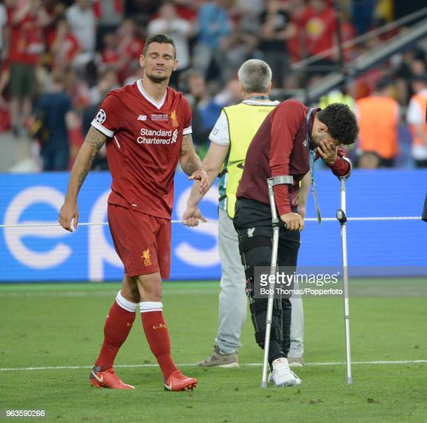 Dejected Liverpool players Dejan Lovren and the injured Alex OxladeChamberlain after the UEFA Champions League Final between Real Madrid and...
