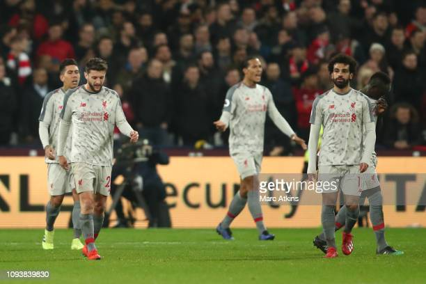 Dejected Liverpool players during the Premier League match between West Ham United and Liverpool FC at London Stadium on February 4 2019 in London...