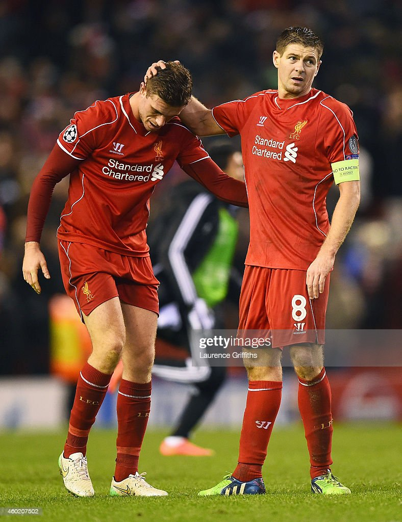 Dejected Liverpool players Jordan Henderson and Steven Gerrard react following their team's 1-1 draw and exit from the competition during the UEFA Champions League group B match between Liverpool and FC Basel 1893 at Anfield on December 9, 2014 in Liverpool, United Kingdom.