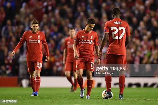 Dejected Liverpool players react after conceding the opening goal during the UEFA Europa League Group B match between Liverpool FC and Rubin Kazan at...