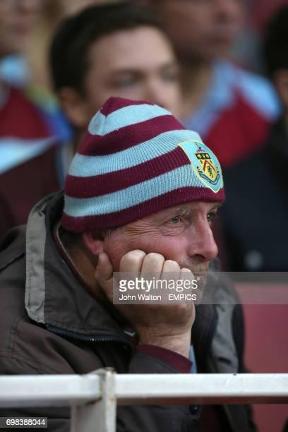 A dejected looking Burnley fan in the stands