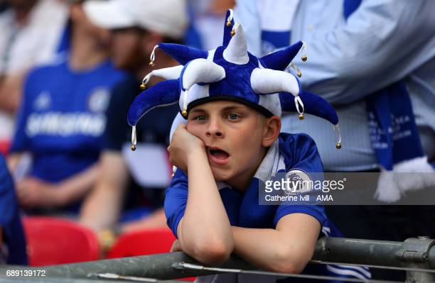 A dejected looking Chelsea fan during the Emirates FA Cup Final match between Arsenal and Chelsea at Wembley Stadium on May 27 2017 in London England
