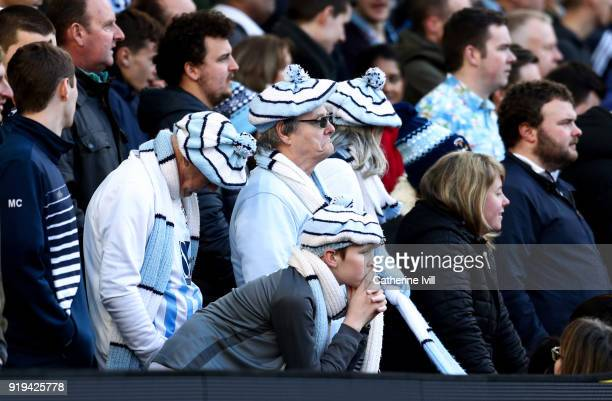 Dejected looking Coventry City fans during the Emirates FA Cup Fifth Round match between Brighton and Hove Albion and Coventry City at Amex Stadium...