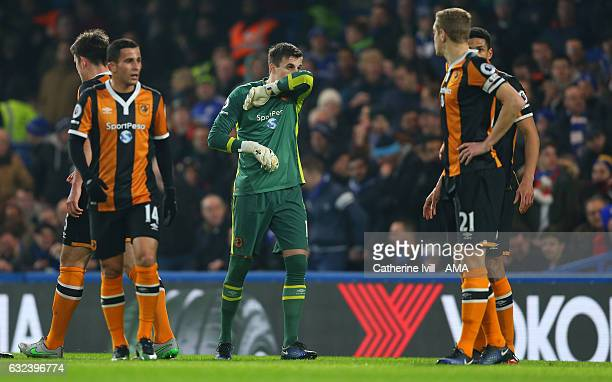 A dejected looking Eldin Jakupovic of Hull City stands amongst his team mates during the Premier League match between Chelsea and Hull City at...