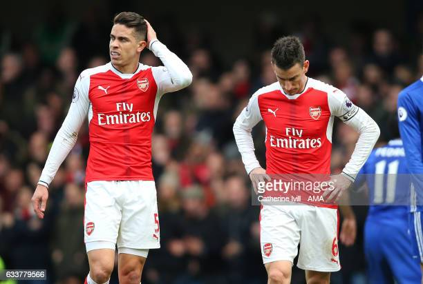 A dejected looking Gabriel Paulista and Laurent Koscielny of Arsenal during the Premier League match between Chelsea and Arsenal at Stamford Bridge...