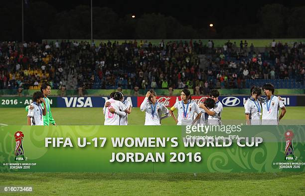 A dejected looking Japan team get together for a Second Placed picture during the FIFA U17 Women's World Cup Jordan 2016 Final match between Korea...