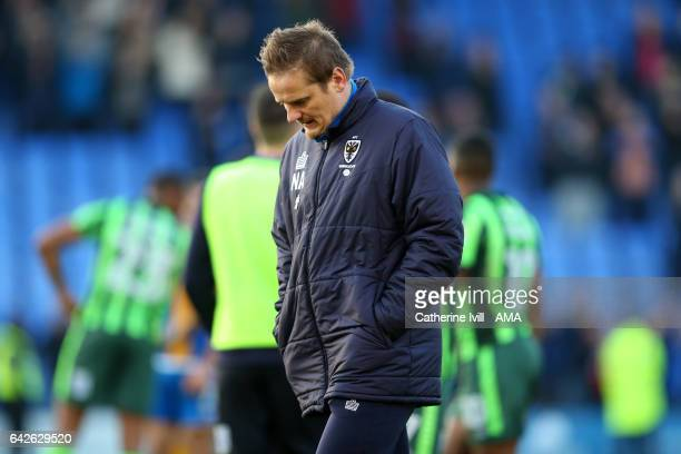 A dejected looking Neal Ardley manager of AFC Wimbledon walks off after the Sky Bet League One match between Shrewsbury Town and AFC Wimbledon at New...