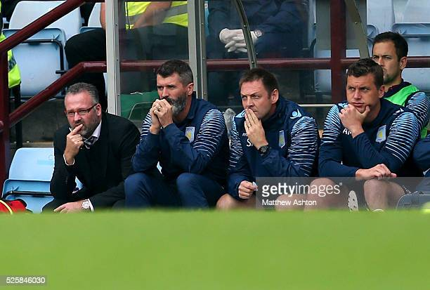 A dejected looking Paul Lambert the head coach / manager of Aston Villa and Roy Keane assistant manager of Aston Villa watch the match