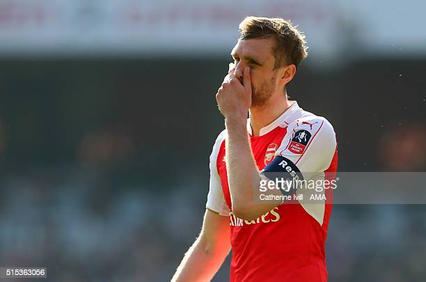A dejected looking Per Mertesacker of Arsenal during the Emirates FA Cup match between Arsenal and Watford at the Emirates Stadium on March 13 2016...