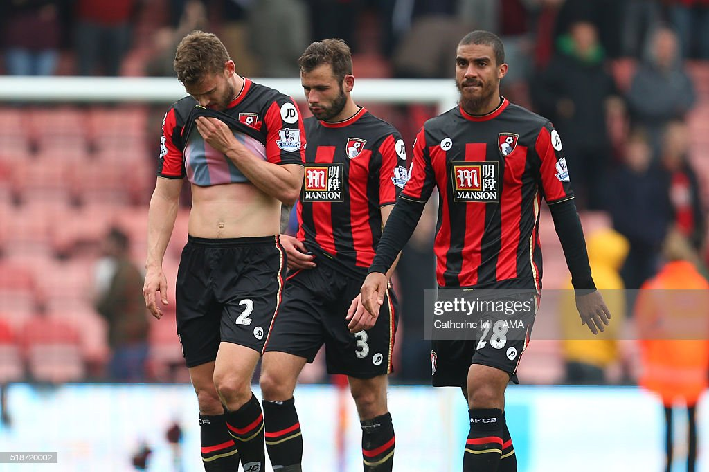 A dejected looking Simon Francis, Steve Cook and Lewis Grabban of Bournemouth walk off at the end of the Barclays Premier League match between AFC Bournemouth and Manchester City at Vitality Stadium on April 2, 2016 in Bournemouth, England.