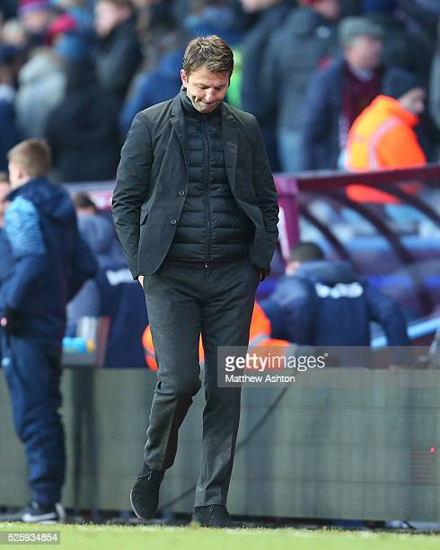 A dejected looking Tim Sherwood the head coach / manager of Aston Villa walks off at the end of the match