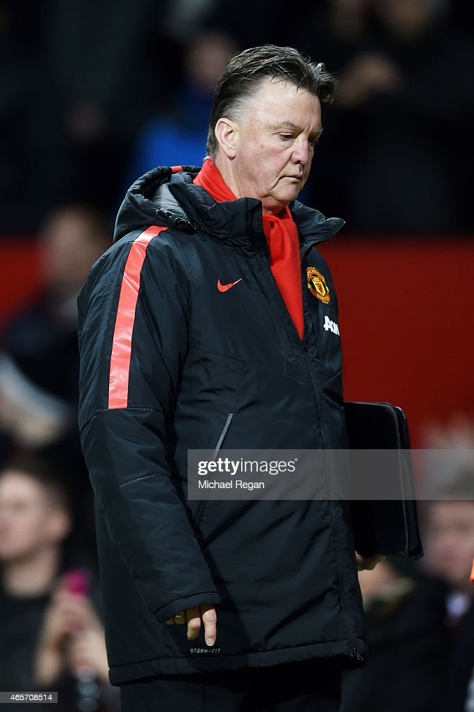 A dejected Louis van Gaal the manager of Manchester United walks off the pitch following his team's 2-1 defeat during the FA Cup Quarter Final match between Manchester United and Arsenal at Old Trafford on March 9, 2015 in Manchester, England.
