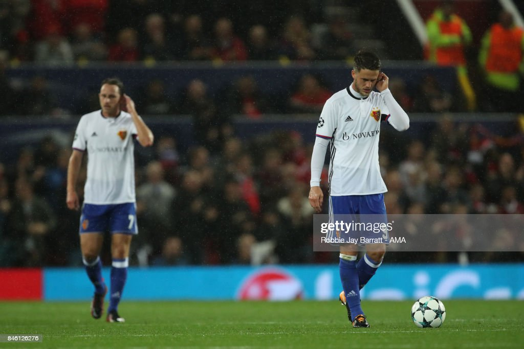 A dejected Luca Zuffi and Ricky van Wolfswinkel of FC Basel after the first goal during to the UEFA Champions League match between Manchester United and FC Basel at Old Trafford on September 12, 2017 in Manchester, England.