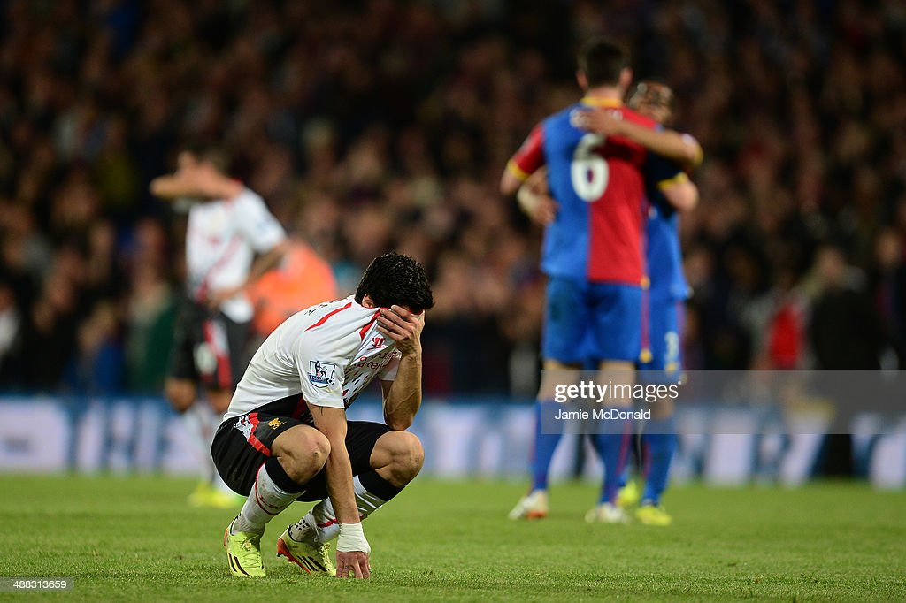 A dejected Luis Suarez of Liverpool reacts following his team's 3-3 draw during the Barclays Premier League match between Crystal Palace and Liverpool at Selhurst Park on May 5, 2014 in London, England.
