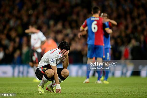 A dejected Luis Suarez of Liverpool reacts following his team's 33 draw during the Barclays Premier League match between Crystal Palace and Liverpool...