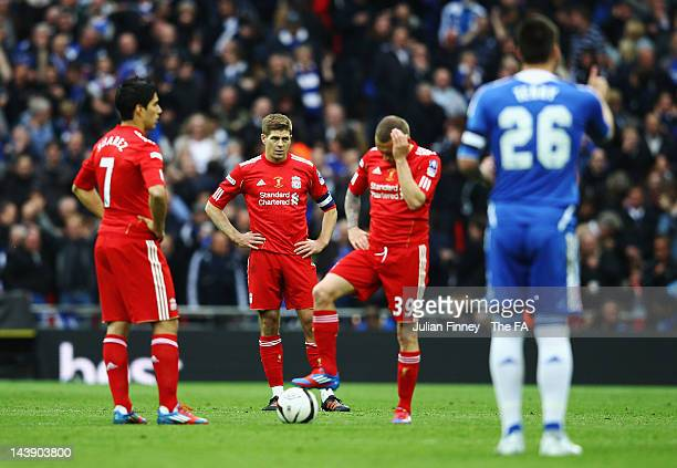 Dejected Luis Suarez, Steven Gerrard and Craig Bellamy of Liverpool at kick off after their team concedes a second goal during the FA Cup Final with...