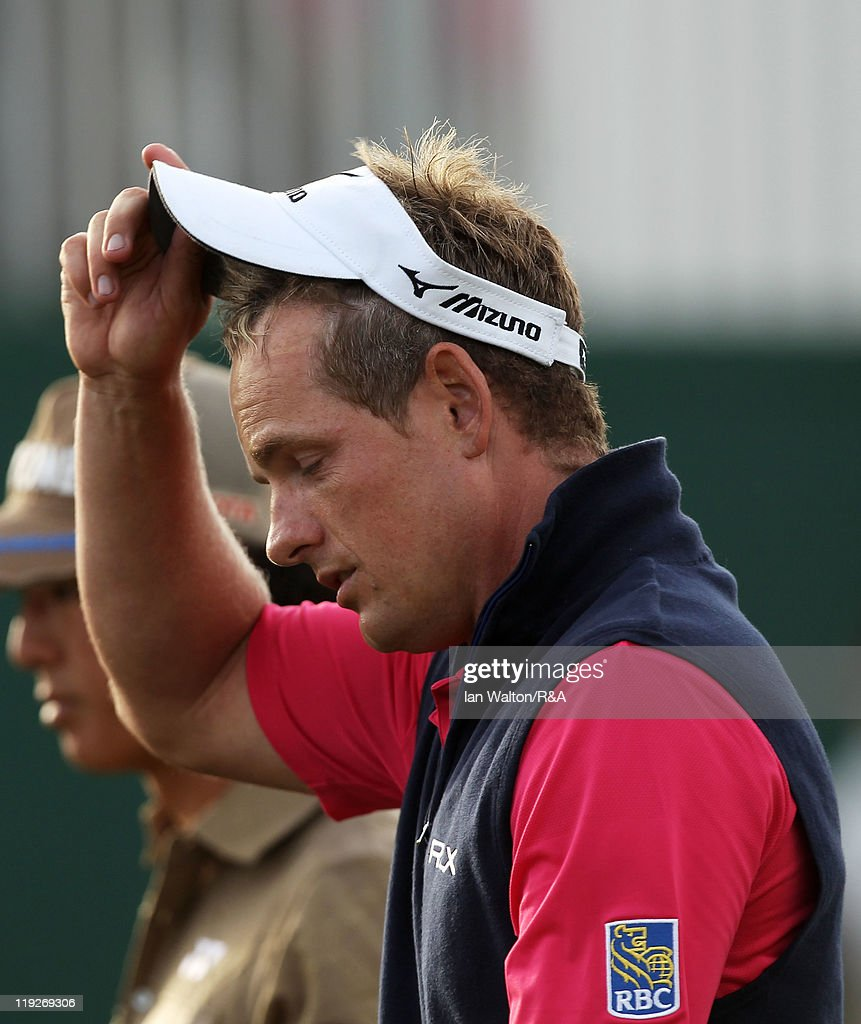 A dejected Luke Donald of England reacts on the 18th green after missing the cut during the second round of The 140th Open Championship at Royal St George's on July 15, 2011 in Sandwich, England.