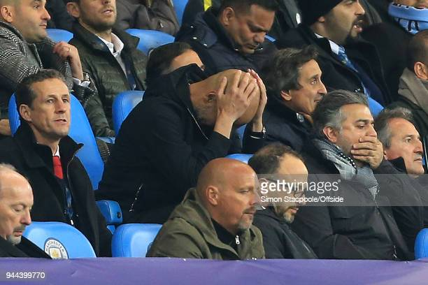 A dejected Man City manager Pep Guardiola holds his head in his hands after Liverpool score their 2nd goal during the UEFA Champions League Quarter...