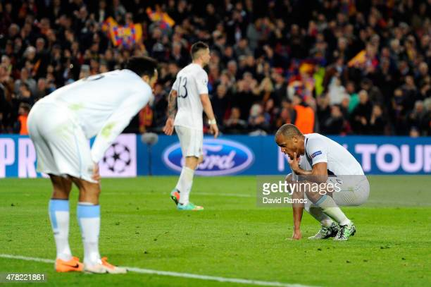 A dejected Manchester City captain Vincent Kompany reacts following his team's 21 defeat during the UEFA Champions League Round of 16 second leg...
