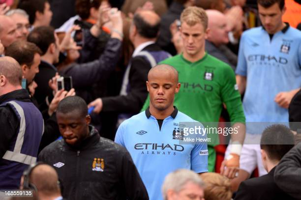 Dejected Manchester City players Yaya Toure Vincent Kompany Joe Hart and Edin Dzeko walk down the steps after receiving their losers medals during...