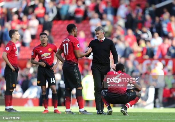 Dejected Manchester United players including Paul Pogba of Manchester United and Ole Gunnar Solskjaer the head coach / manager of Manchester United...