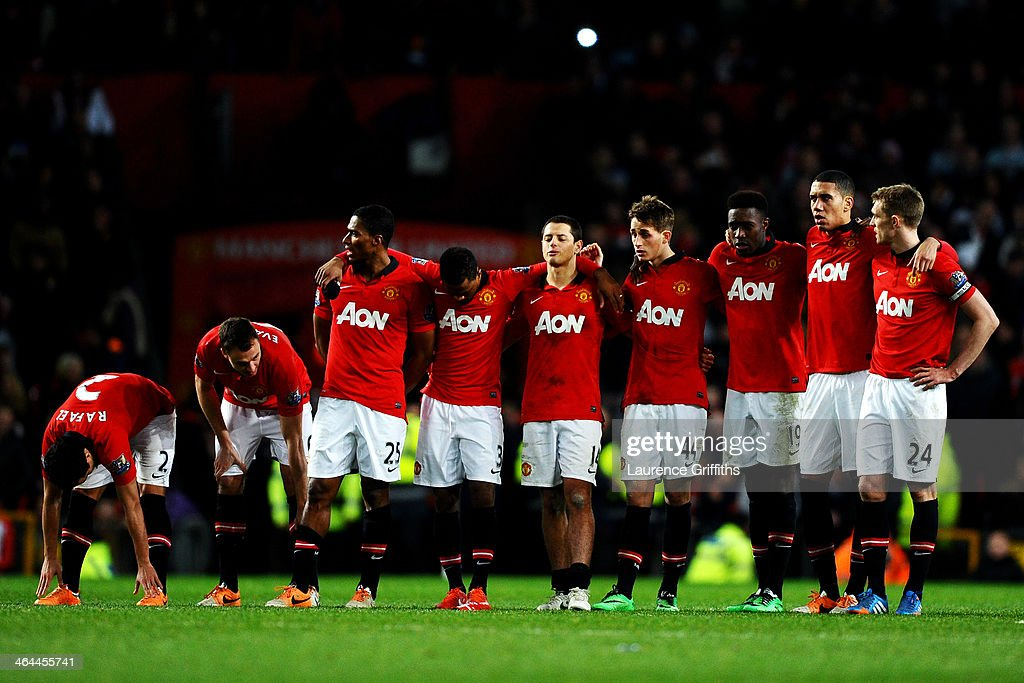 Dejected Manchester United players line up as the penalty shootout carries on during the Capital One Cup semi final, second leg match between Manchester United and Sunderland at Old Trafford on January 22, 2014 in Manchester, England.