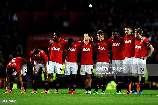 Dejected Manchester United players line up as the penalty shootout carries on during the Capital One Cup semi final second leg match between...