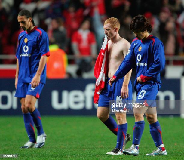 Dejected Manchester United players Rio Ferdinand Paul Scholes and JiSung Park trudge off the pitch having been eliminated from the Champions League...