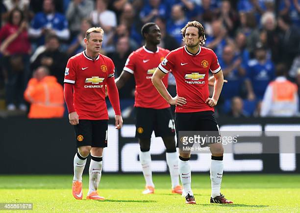 Dejected Manchester United players Wayne Rooney, Tyler Blackett and Daley Blind look on during the Barclays Premier League match between Leicester...