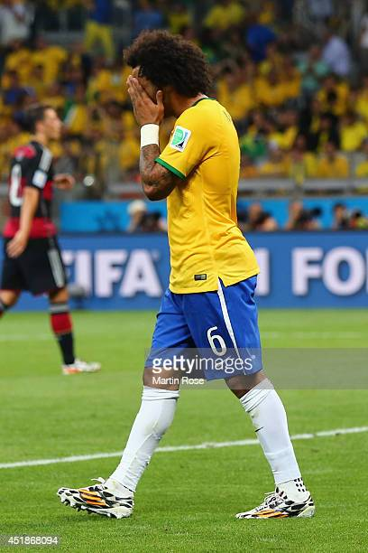 Dejected Marcelo of Brazil reacts after Germany's seventh goal during the 2014 FIFA World Cup Brazil Semi Final match between Brazil and Germany at...