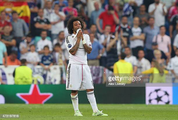 A dejected Marcelo of Real Madrid reacts following his team's exit from the competition during the UEFA Champions League Semi Final second leg match...