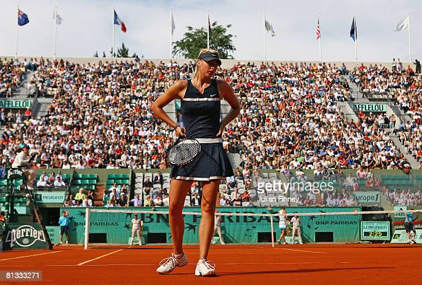 Dejected Maria Sharapova of Russia feels the pressure as she heads towards defeat during the Women's Singles fourth round match against Dinara Safina...
