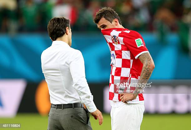 Dejected Mario Mandzukic of Croatia speaks with head coach Niko Kovac after the 13 defeat in the 2014 FIFA World Cup Brazil Group A match between...