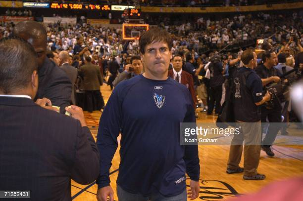 A dejected Mark Cuban owner of the Dallas Mavericks walks off the court after Game Six of the 2006 NBA Finals on June 20 2006 at American Airlines...