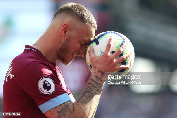 Dejected Marko Arnautovic of West Ham rests his head on the ball after missing a chance during the Premier League match between West Ham United and...