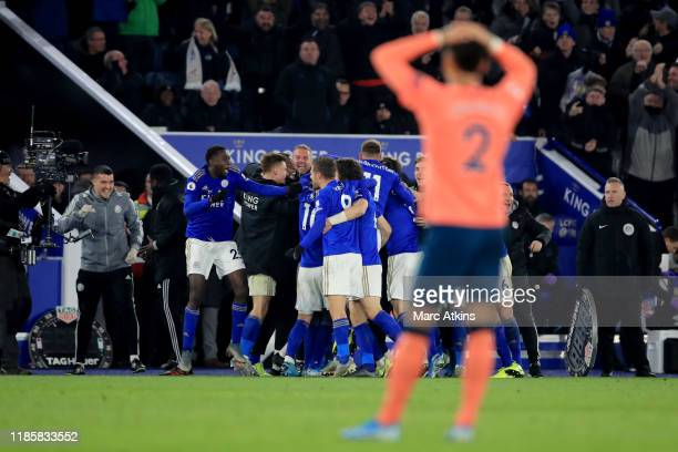 Dejected Mason Holgate of Everton looks on as Leicester City players celebrate the winner during the Premier League match between Leicester City and...