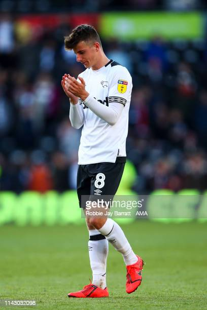 A dejected Mason Mount of Derby County applauds the fans at full time during the Sky Bet Championship Playoff Semi Final First Leg match between...