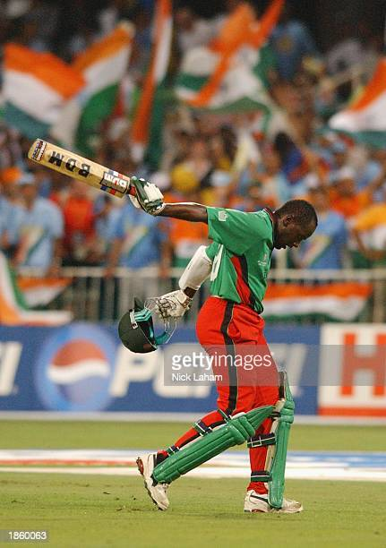 Dejected Maurice Odumbe of Kenya walks back to the pavilion during the Cricket World Cup second semi final match between India and Kenya held at...