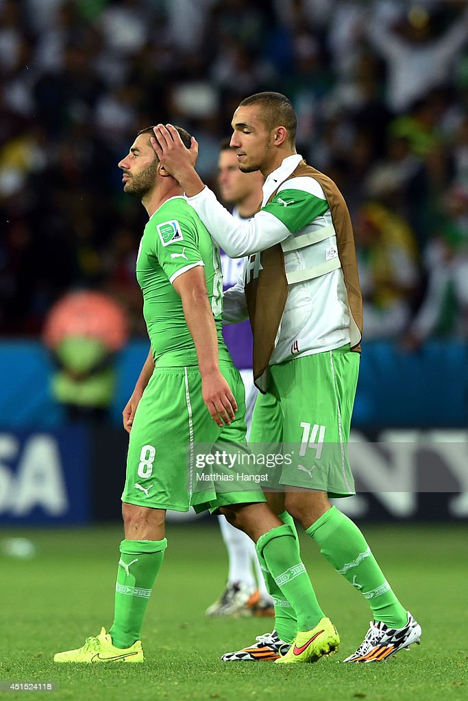 A dejected Medhi Lacen (L) and Nabil Bentaleb of Algeria look on after being defeated by Germany 2-1 during the 2014 FIFA World Cup Brazil Round of 16 match between Germany and Algeria at Estadio Beira-Rio on June 30, 2014 in Porto Alegre, Brazil.
