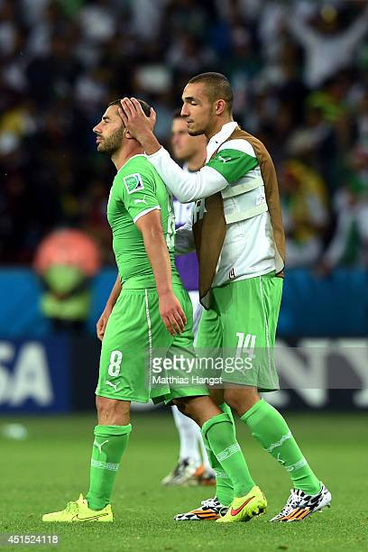 A dejected Medhi Lacen and Nabil Bentaleb of Algeria look on after being defeated by Germany 21 during the 2014 FIFA World Cup Brazil Round of 16...