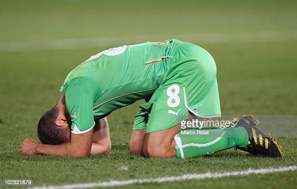 A dejected Medhi Lacen of Algeria after defeat and elimination in the 2010 FIFA World Cup South Africa Group C match between USA and Algeria at the...