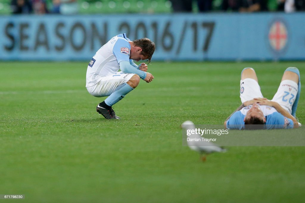 Dejected Melbourne City players slump to the ground after the A-League Elimination Final match between Melbourne City FC and the Perth Glory at AAMI Park on April 23, 2017 in Melbourne, Australia.