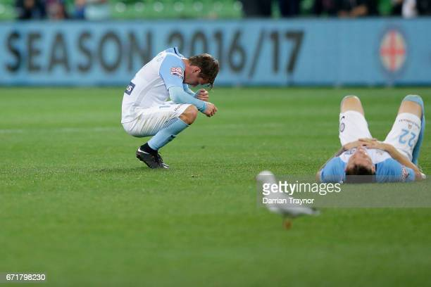 Dejected Melbourne City players slump to the ground after the ALeague Elimination Final match between Melbourne City FC and the Perth Glory at AAMI...