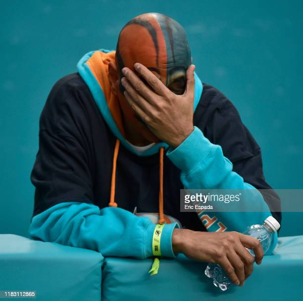 A dejected Miami Dolphins fan during the fourth quarter of the game against the Buffalo Bills at Hard Rock Stadium on November 17 2019 in Miami...