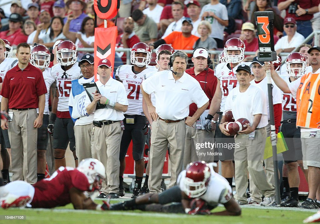 A dejected Mike Leach head coach of the Washington State Cougars looks on as his receiver falls short of the first down marker during a game against the Stanford Cardinal at Stanford Stadium on October 27, 2012 in Palo Alto, California.