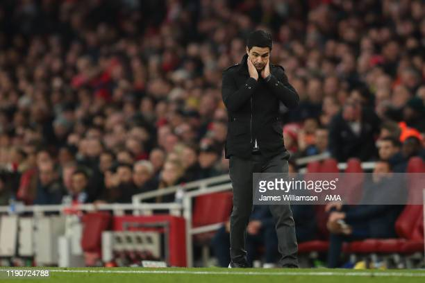 A dejected Mikel Arteta the manager / head coach of Arsenal during the Premier League match between Arsenal FC and Chelsea FC at Emirates Stadium on...