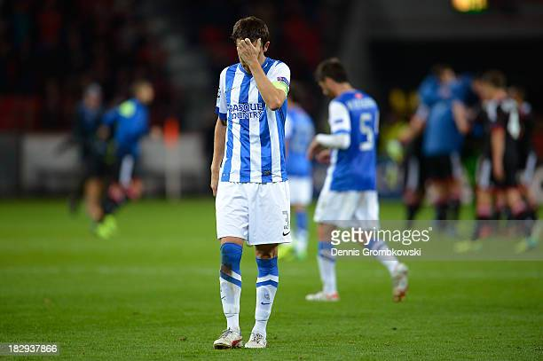 A dejected Mikel Gonzalez of Real Sociedad walks off the pitch following his team's 21 defeat during the UEFA Champions League Group A match between...