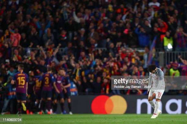 Dejected Mohamed Salah of Liverpool as Lionel Messi of FC Barcelona celebrates after scoring a goal to make it 2-0 during the UEFA Champions League...