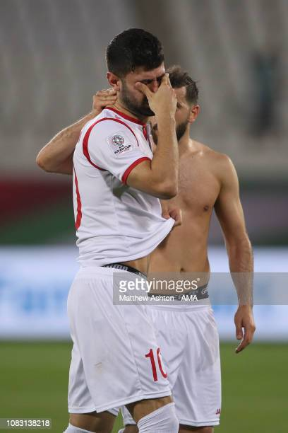 Dejected Mohammed Osman of Syria reacts at full time during the AFC Asian Cup Group B match between Australia and Syria at Khalifa Bin Zayed Stadium...