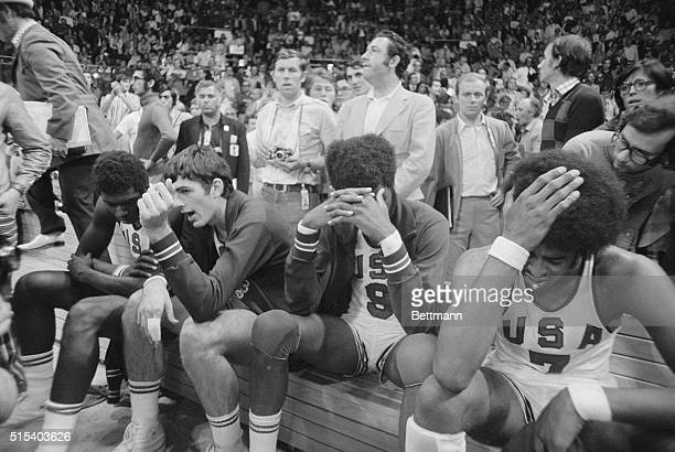 Dejected. Munich, West Germany: Dejected members of American basketball team sit on their bench after losing close game to USSR, in Olympic...